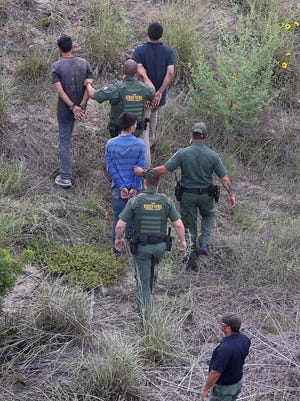 Border Patrol agents detain undocumented immigrants in Texas.