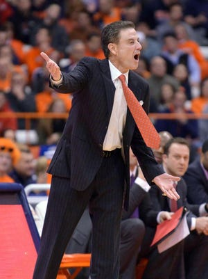Feb 18, 2015; Syracuse, NY, USA; Louisville Cardinals head coach Rick Pitino shouts out to his team during the first half of a game against the Syracuse Orange at the Carrier Dome. Syracuse won the game 69-59. Mandatory Credit: Mark Konezny-USA TODAY Sports