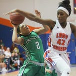 Fort Myers player Jarya Outten, left, is fouled by Cape Coral's Deidre Cheremound Friday in Cape Coral.