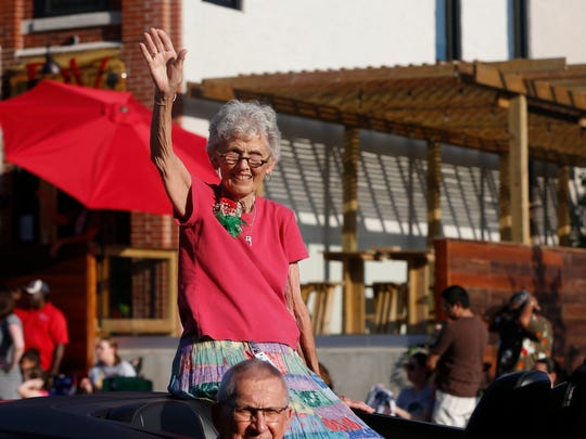 Grand Marshal Arlette Hollister, superintendent of the Food Department at the Iowa State Fair, waves to the crowd Wednesday, Aug. 12, 2015, during the Iowa State Fair Parade in Des Moines.