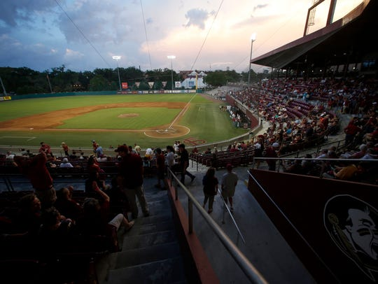 Fans wait out a weather delay between FSU and Miami