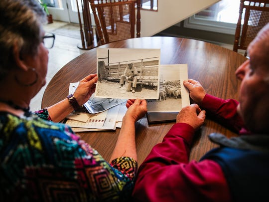 Becky and Karl Bookter look at a photo of Becky's father Wednesday, Jan. 31, 2018, at their San Angelo home.