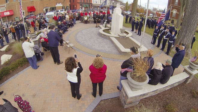 A crowd gathers around the Veterans Memorial outside the historical Livingston Courthouse for the annual Veterans Day ceremony Tuesday.
