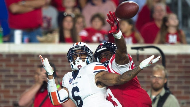 Auburn defensive back Carlton Davis (6) attempts to intercept the ball as Mississippi wide receiver Damore'ea Stringfellow (3) deflects it away during the NCAA football game between Auburn and Mississippi at Vaught-Hemingway Stadium on Saturday, Oct. 29, 2016, in Oxford, Miss.