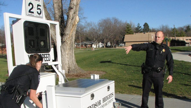 Windsor Heights Police Lt. Derek Meyer demonstrates one of the city's mobile speed enforcement cameras.