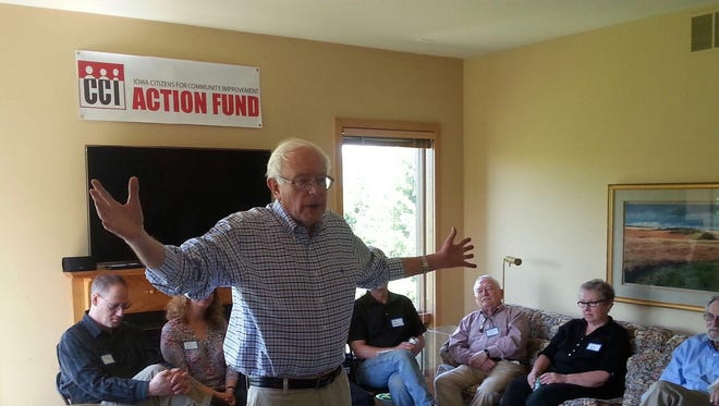 U.S. Sen. Bernie Sanders, I-Vt., meets supporters of Iowa Citizens for Community Improvement during a May visit to Iowa City.