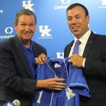 UK athletic director Mitch Barnhart, left, introduces new baseball coach Nick Mingione, right, at a news conference on June 14, 2006.