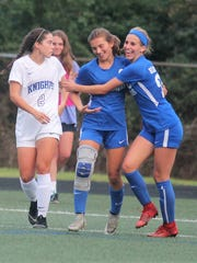 Highlands sophomore Greta Noble, middle, is congratulated
