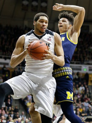 Purdue center A.J. Hammons (20) grabs a rebound in front of Michigan forward D.J. Wilson (5) during the first half of an NCAA college basketball game in West Lafayette, Ind., Thursday, Jan. 7, 2016. (AP Photo/Michael Conroy)