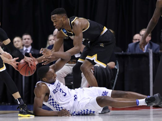 UK's Bam Adebayo (3) scrambled for a loose ball against