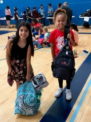 Aaliyah Sanchez and Samantha Skeeters show off their new backpacks at a Boys & Girls Club of Camarillo event in this file photo.