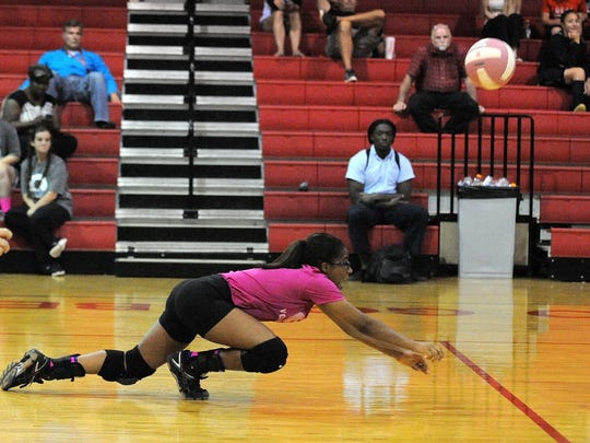 Evangel's Alexis Tademy dives for a dig against North Caddo on Tuesday night.