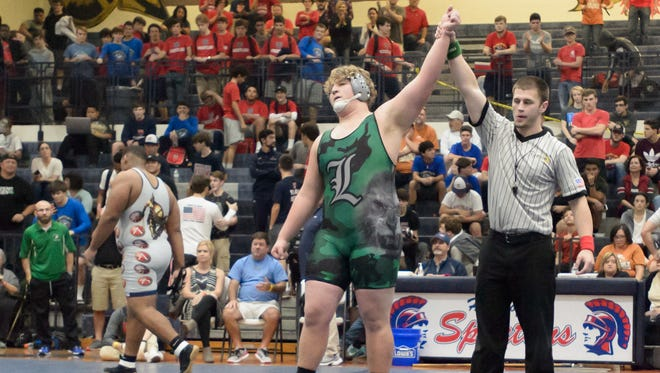 Lafayette High's David Hudson, shown here winning the Ken Cole crown, is the No. 3 seed in the 285-pound weight division at the state tournament.