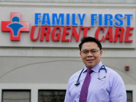 Dr. Richard Mojares, medical director and owner of Family First Urgent Care, poses in the front of Family First Urgent Care in Ocean Township.