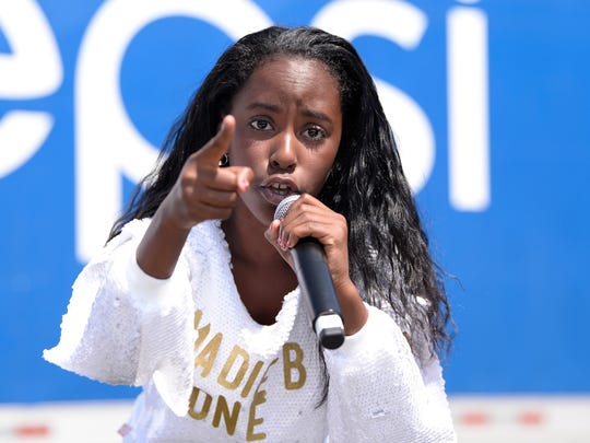 Madie B.One, 11, performs for the crowd on the main stage during the 36th annual Metro Detroit Youth Day on Belle Isle on Wednesday.