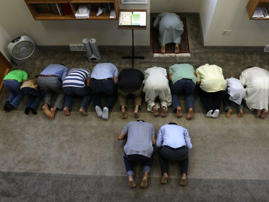 Men perform sujud during Friday prayers at Masjid Al-Noor, central Wisconsin's only mosque, May 27, 2016.