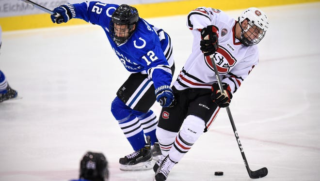 St. Cloud State's Jack Poehling skates past University of Alabama-Huntsville's Regan Soquila during the first period of the Friday, Oct. 28, game at the Herb Brooks National Hockey Center in St. Cloud.