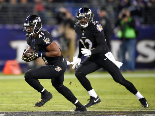 Baltimore Ravens cornerback Anthony Levine (41) rushes the ball after intercepting a pass attempt in the second half of an NFL football game against the Houston Texans, Monday, Nov. 27, 2017, in Baltimore. Baltimore won 23-16. (AP Photo/Nick Wass)
