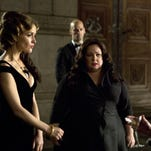 "Melissa McCarthy (center) infiltrating an arms dealing ring led by Rose Byrne (left) in a scene from ""Spy."""