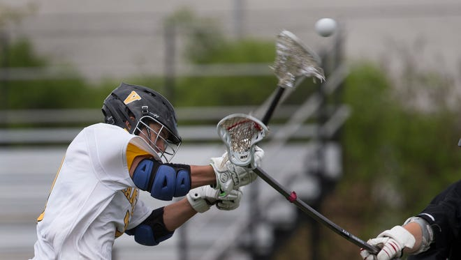 St. John Vianney's Nick Moss takes a shot on goal during first half action. St John Vianney Boys Lacrosse edges out Jackson Memorial in Shore Conference Tournament in Holmdel NJ on May 6, 2017.