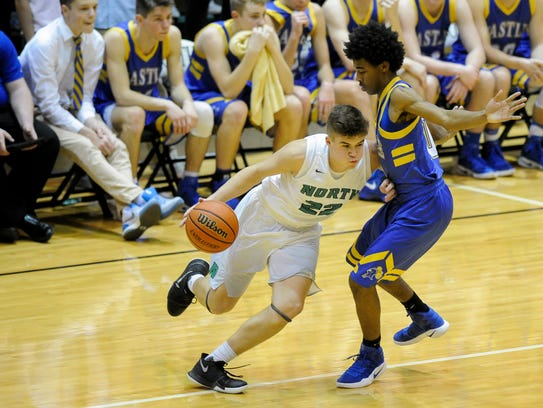 North's Cameron Seaton (22) drives past Castle's Shawn