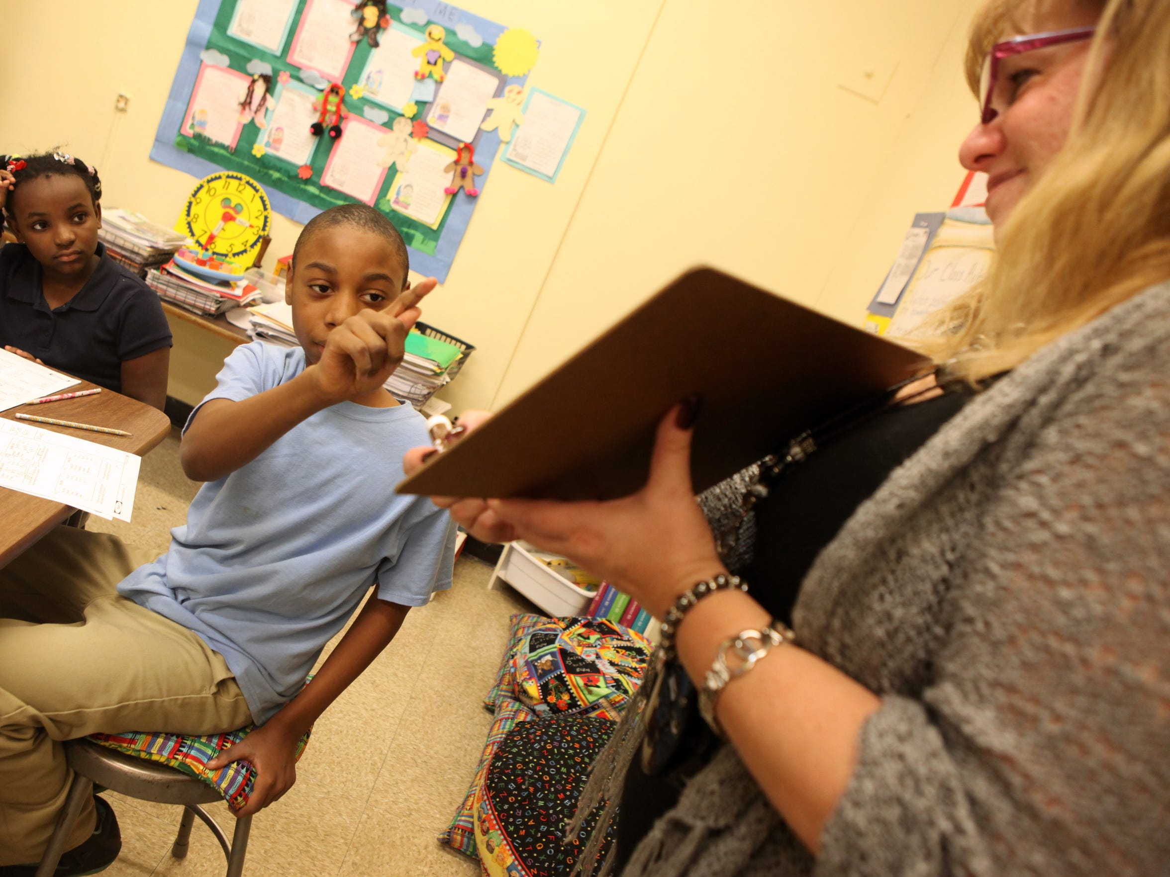Trevyan Rowe points toward MeChele Markajani, a consultant teacher at School 12, in a special education class in February 2015.