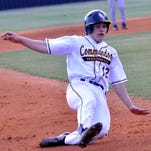 Hendersonville High senior Connor Fischer slides safely into third base during the first inning.