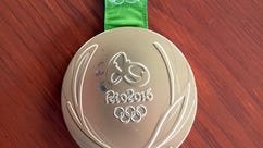 This photo provided by Kevin Snyder show Kyle Snyder's damaged gold metal from the 2016 Rio Olympics on Tuesday, May 23, 2017, in Maryland. The medal will soon replaced by the IOC and Rio organizers because of damage. Snyder and Helen Maroulis, another U.S. gold medalist wrestler, are among a group of more than 100 athletes from around the world with defective Olympic medals. (Kevin Snyder via AP)