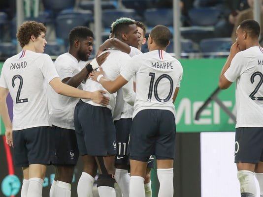France's Paul Pogba, centre, celebrates with his teammates after scoring his side's second goal during the international friendly soccer match between Russia and France at the Saint Petersburg stadium in St.Petersburg, Russia, Tuesday, March 27, 2018. (AP Photo/Dmitri Lovetsky)