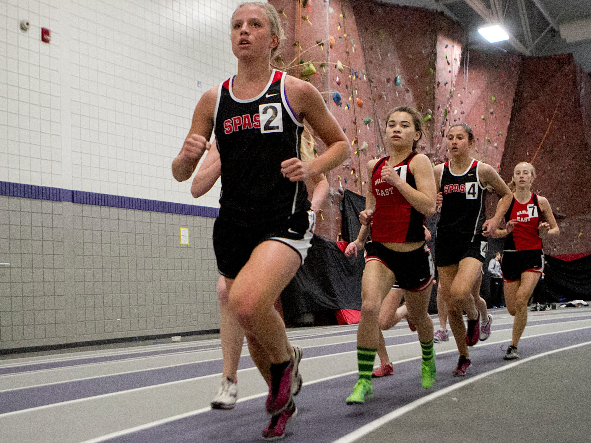 Stevens Point Area Senior High's Hannah Beilke leads the pack during the 1,600 meters during the Wisconsin Valley Conference Indoor Track and Field Invitational at University of Wisconsin-Stevens Point.