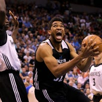 Minnesota Timberwolves center Karl-Anthony Towns, right, goes to the basket against Timberwolves center Gorgui Dieng, left, during an NBA basketball scrimmage in Minneapolis, Wednesday, July 8, 2015.  (AP Photo/Ann Heisenfelt)