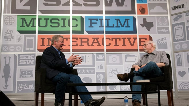 Former U.S. Vice President Al Gore, left, speaks with Wall Street Journal columnist Walt Mossberg during an interview at the South by Southwest Interactive Festival (SXSW) in Austin, Texas, U.S., on Saturday, March 9, 2013. The 20th annual SXSW Interactive Festival takes place March 8-12. Photographer: David Paul Morris/Bloomberg *** Local Caption *** Al Gore; Walt Mossberg