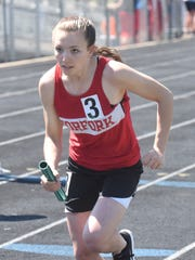 Norfork's Ivy McGowan runs a relay leg during the 1A-2