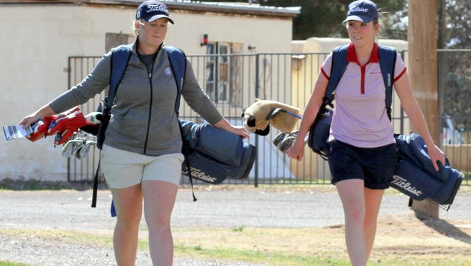 From left, sophomores Presley Jackson and Dezi Stockton walk to the No. 10 tee box during a Wednesday practice round at the Rio Mimbres Golf Course. Jackson led the Lady Cats to a tournament win at the Alamogordo High Invitational Tournament on Monday, March 12, 2018.