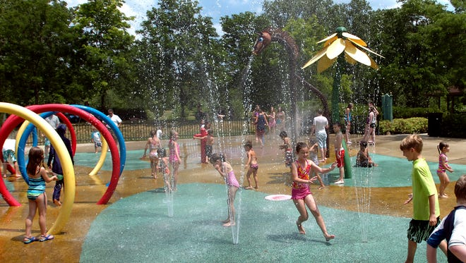 "Children play at the ""sprayscape"" at Plymouth Township Park. The township and city of Plymouth have hired a firm to survey residents about recreation needs."