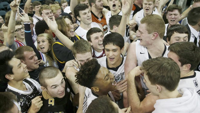 Lakota East celebrates after upsetting Wayne in the district final in March.