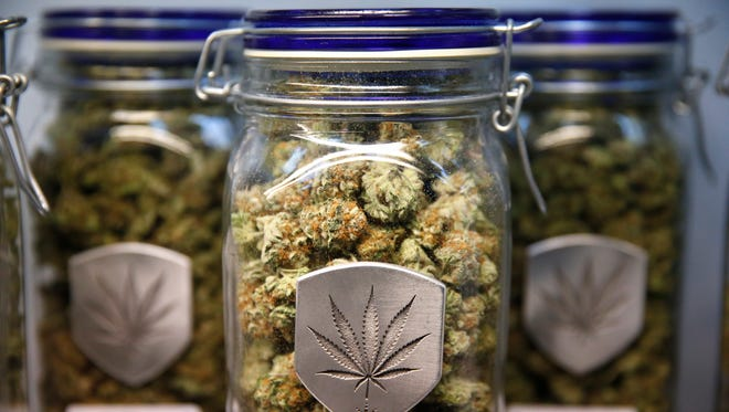 Different strains of pot are displayed for sale Dec. 27, 2013, at Medicine Man marijuana dispensary in Denver. Medicine Man was among the first batch of Denver businesses to receive a license allowing them to legally sell recreational marijuana.