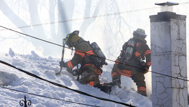 Mahopac firefighters had to shovel snow from a roof before they could use their saws to ventilate a house fire in a home on East Lake Blvd in Mahopac Feb. 26, 2014. A Mahopac firefighter was injured and transported to Putnam Hospital Center. Mahopac Falls firefighters assisted at the scene.