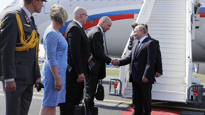 Russian President Vladimir Putin is welcomed upon his arrival at Helsinki Airport in Helsinki, Finland.