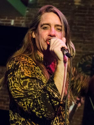 Scott Dambacher, who plays Hedwig, rehearses for the July 4 performance of Hedwig and the Angry Inch at Lynch's Irish Tavern