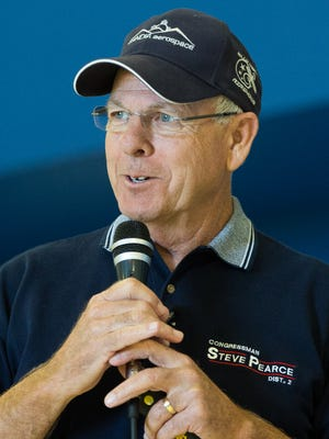 "Congressman Steve Pearce describes his  flight around the world to honor veterans earlier this year. Pearce gave a ""Fly-in"" for local veterans, where he discussed his flight, Saturday October 22, 2016 at the Las Cruces International Airport."