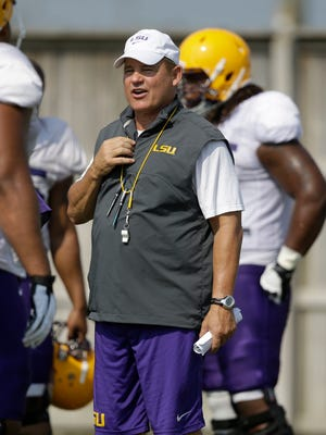 LSU coach Les Miles said Monday that he knows which quarterback will start Saturday night against Wisconsin, but he wouldn't say who and he reiterated that both Anthony Jennings and Brandon Harris would play against the Badgers.