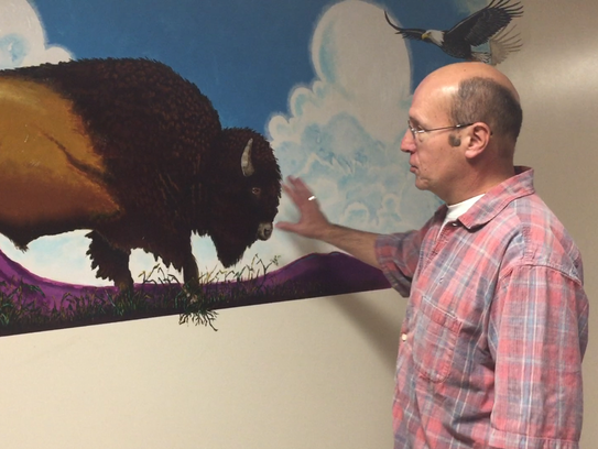 Jay Luchsinger painted a mural of a bison, butte, gopher