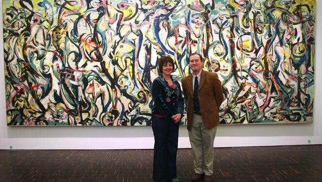 """University of Iowa Museum of Art Interim Director Pamela White and Figge Art Museum Executive Director Sean O'Harrow stand in front of Jackson Pollock's """"Mural"""" on Monday, March 16, 2009, after the painting was moved into the Figge Art Museum in Davenport earlier that day."""
