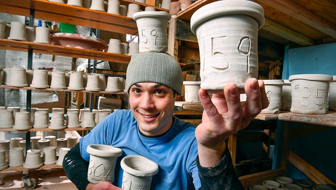 Joel Cherrico shows the 159 pots he threw in his attempt to break the Guinness World Record Friday, March 25, at his studio in St. Joseph.