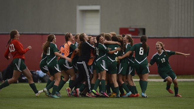 Members of the D.C. Everest girls soccer team celebrate after winning the Division 1 state championship game last June
