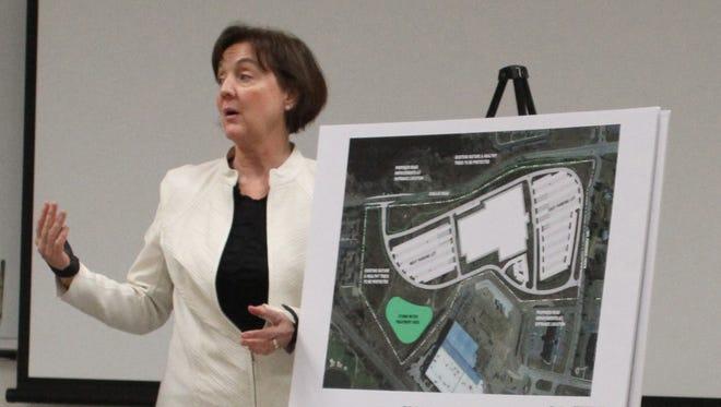 University of Michigan planner Sue Gott presents a preliminary design of the proposed Brighton Health Center to the Brighton City Council on Thursday.