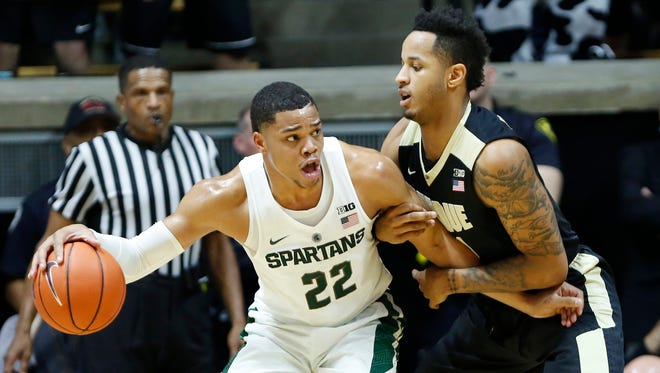 Vincent Edwards marks Miles Bridges of Michigan State Saturday, February 18, 2017, at Mackey Arena. Purdue defeated Michigan State 80-63.