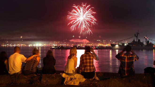 Families watch the Port Orchard Fathoms Fireworks show  from Manette on Saturday. LARRY STEAGALL / KITSAP SUN