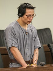 Dong Biao Lin listens to a translation as he is sentenced for the 2010 murders of Yao Chen and his sister Yun Juan Chen in Freehold.